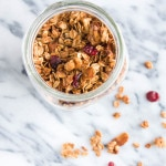 Holiday Gingerbread Granola is spiced with cinnamon, ginger, cloves, and molasses - make some to have on hand for Christmas guests!