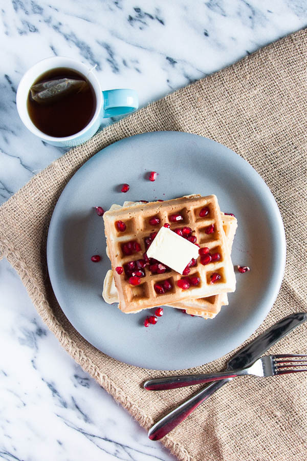 Eggnog Waffles are creamy, sweetly spiced with nutmeg, and excellent for holiday breakfasts!