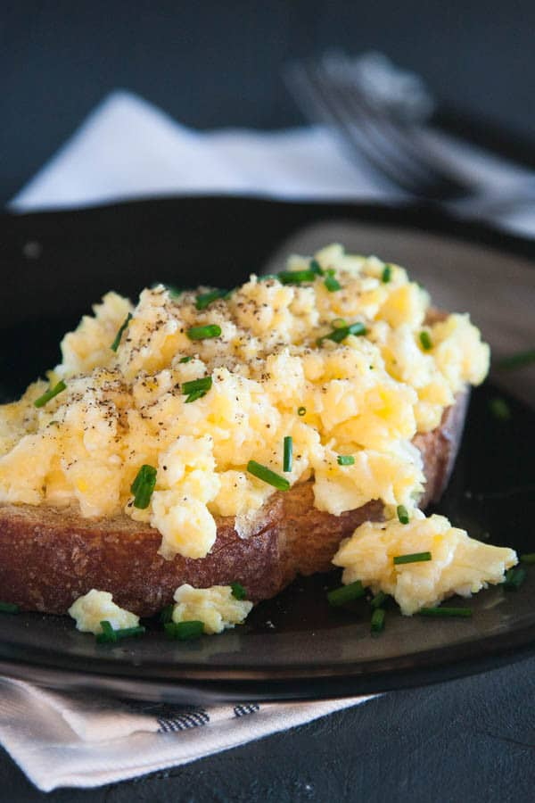 These scrambled eggs are a GAME CHANGER. They are FLUFFY and CREAMY and SIMPLE and everything you could ever want in a scrambled egg!