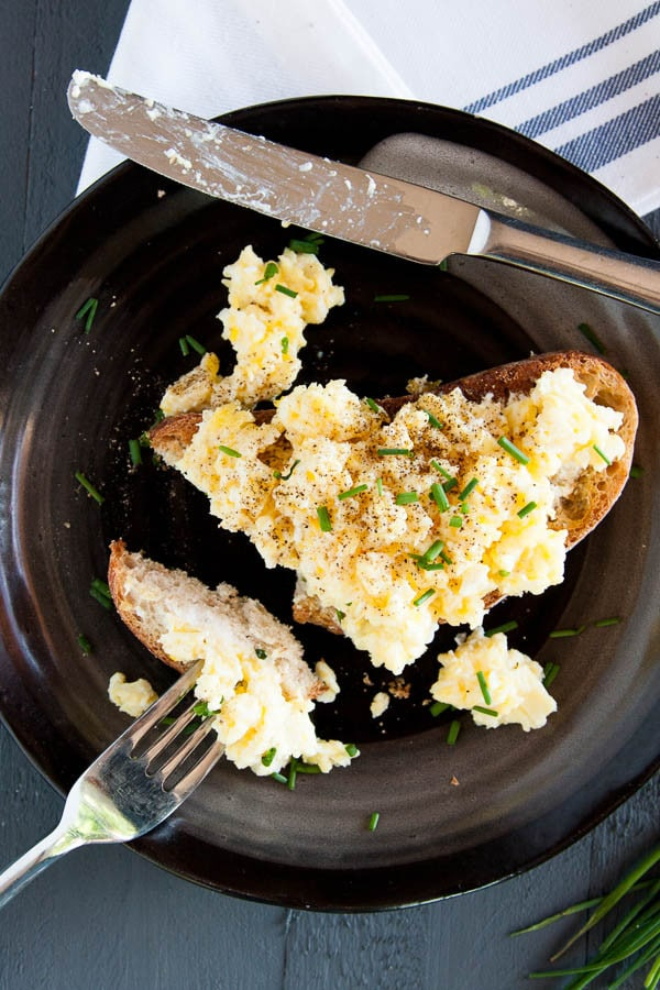 Fluffy scrambled eggs are made with only two ingredients and are a GAME-CHANGER! Try them for breakfast this weekend!