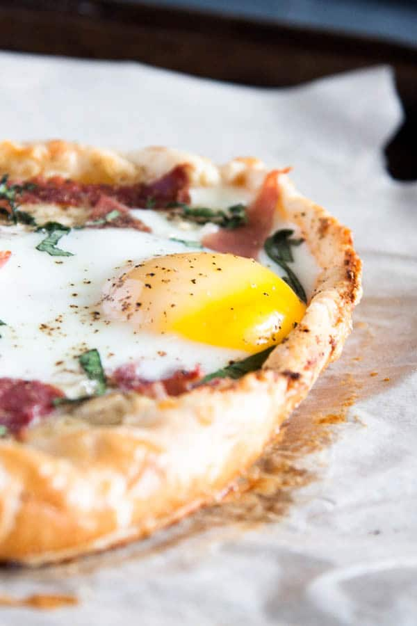 Breakfast Galette: filled with creamy ricotta and mozzarella cheese, and then topped with proscuitto, basil, and a big fat egg.