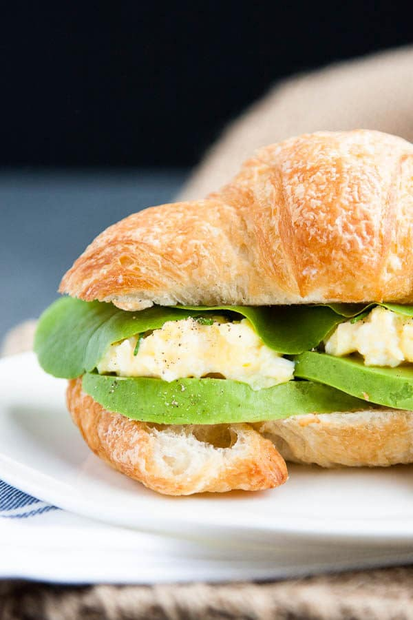 Take a flaky croissant, fluffy scrambled eggs, and slices of rich avocado, pair it with a few leaves of butter lettuce (I've used the lettuce from our garden!) and you have one helluva breakfast sandwich.