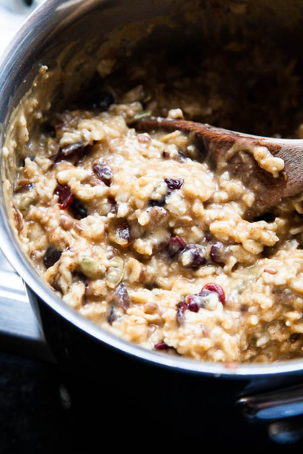 This bubbling pot of warm, creamy Stovetop Oatmeal is an homage to the autumn season with pumpkin puree, dried cranberries, pecans, and warming spices.