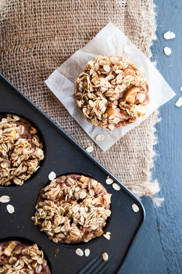 Baked Apple Cinnamon Oatmeal is prepared in muffin cups to take to go! | Breakfast for Dinner