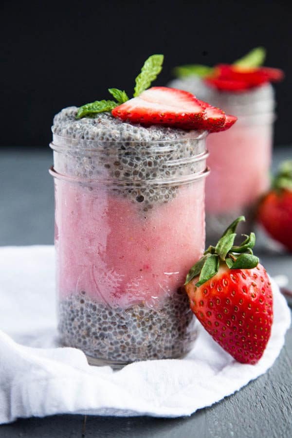 Layers of thick Greek-style Vanilla Chia Pudding are layered with strawberry puree and topped with fresh strawberry slices.