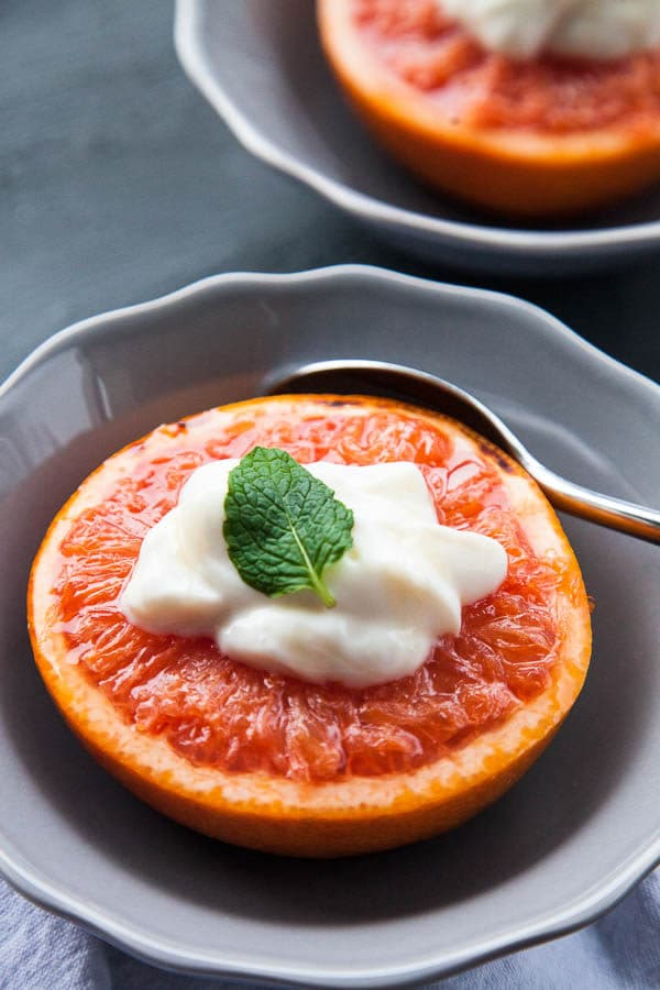 Warm caramelized broiled grapefruit is served with a dollop of Greek yogurt and a drizzle of honey, that tastes like dessert for breakfast.
