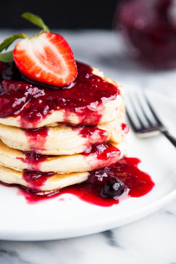 Buttermilk pancakes are light, fluffy, and smothered in a sticky sweet triple berry drizzle. | breakfast for dinner