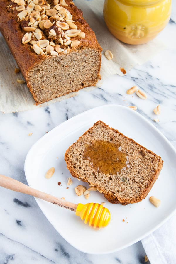 My very favourite 3-banana Banana Bread recipe is thrown together with a big scoop of peanut butter and sprinkled with a crunchy peanut topping.