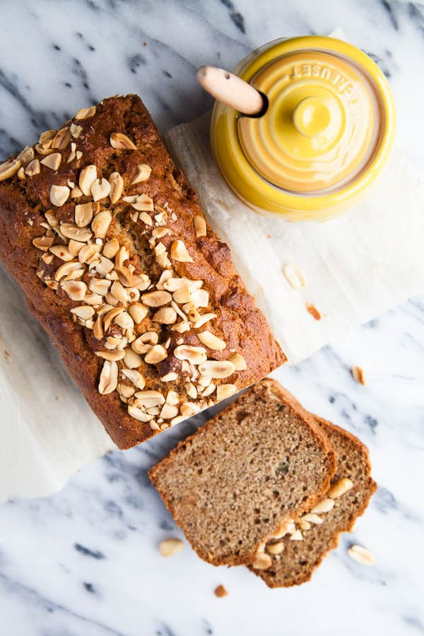My very favourite moist 3-banana Banana Bread recipe is thrown together with a big scoop of peanut butter and sprinkled with a crunchy peanut topping.