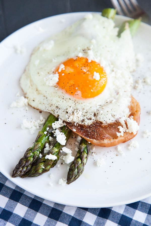 This is a simple sheet pan breakfast celebrating the Spring flavours of fresh asparagus. Roasted asparagus sprigs are stacked with crispy prosciutto, a soft fried egg, and crumbles of creamy goat cheese and it is the perfect combination of roasty, salty, and creamy.