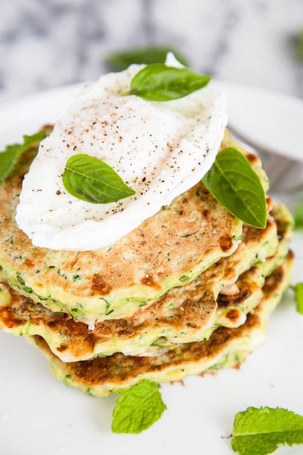 Zucchini Feta Fritters use the freshest summertime flavours - filled with shaved zucchini, chopped mint, and basil, you might already have the ingredients growing in your garden!