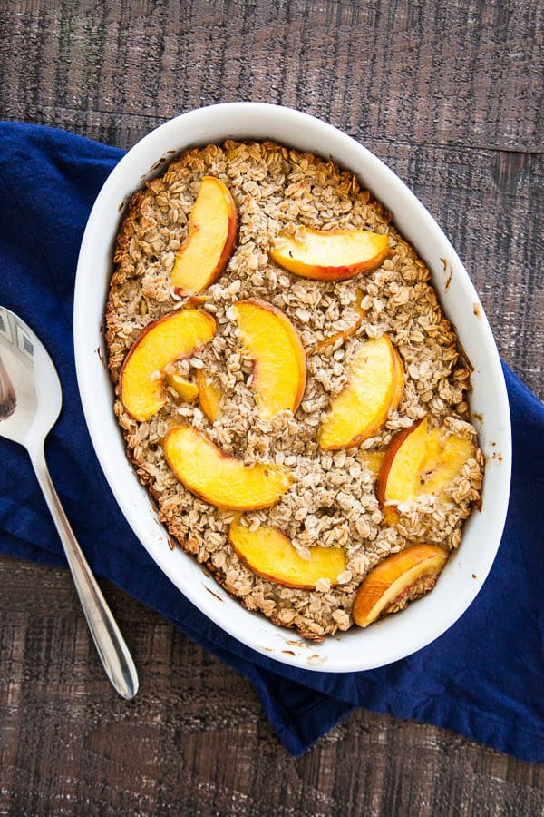 Warm your kitchen with a cozy bowl of Baked Peaches and Cream Oatmeal, while the mornings are still cool and the markets are still stocked with peaches.