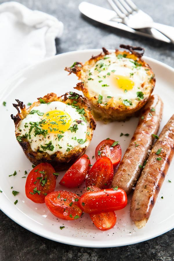 """Shredded sweet potatoes and grated parmesan cheese form a hashbrown """"nest"""" surrounding soft baked eggs - giving you all your breakfast favourites in one convenient portion."""