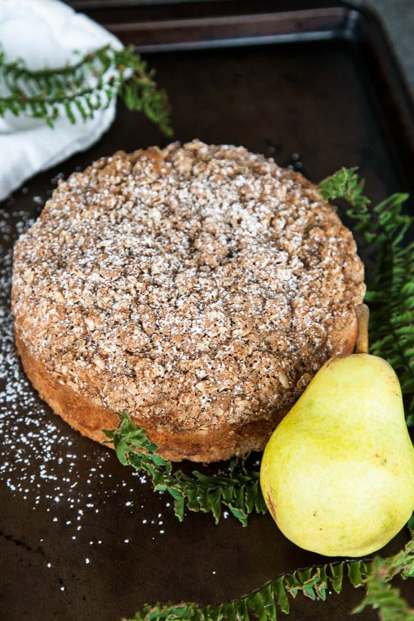 Spiced Pear Crumble Cake is packed with juicy pear, warm cinnamon, and generously sprinkled with a crumbly brown sugar oat topping.