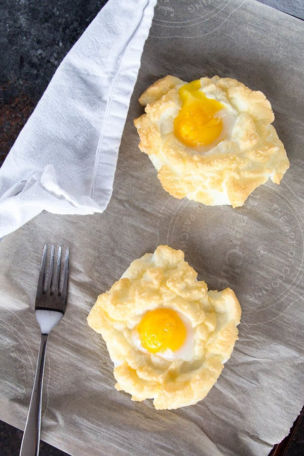 Cloud Eggs are a fun new way to eat eggs for breakfast: you get light, fluffy whites with a perfectly runny yolk. The absolute best of both worlds.