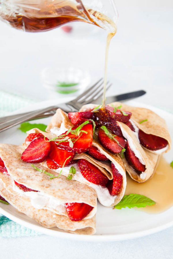 These crepes may look like an indulgent treat, but by using 100% whole wheat flour, fresh fruit, and coconut cream, you can feel good about eating these crepes at any time of day - breakfast or dinner!