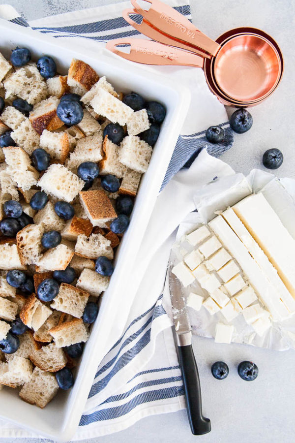 Assembling Blueberry Cream Cheese French Toast Bake