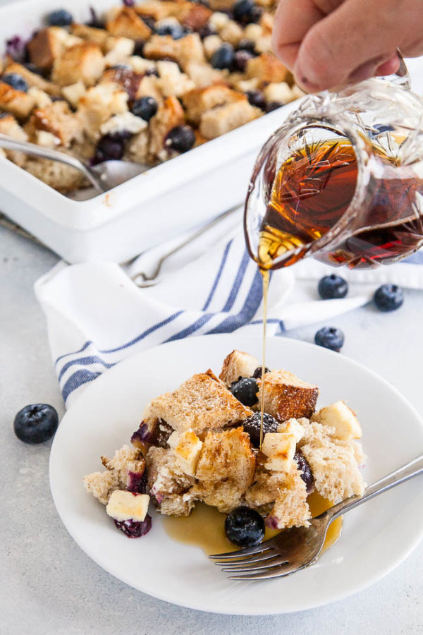 Slightly toasted and top, soft in the middle and each bite bursting with a pocket of fluffy cream cheese and warm exploding blueberries - this french toast bake is perfect for the holidays because you can make it overnight!